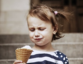 A little girl unhappy with her ice cream