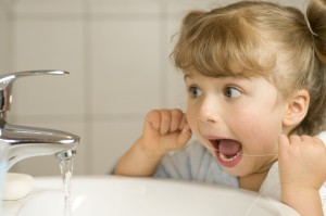 Children's dentist in Castle Pines educates parents on when their kids should start flossing their teeth.