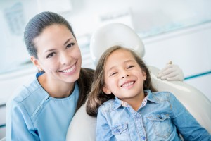 smiling child with dentist