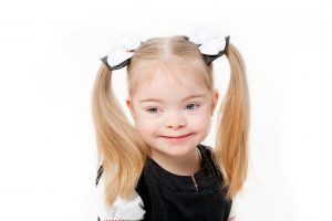 young girl smiling with blond hair