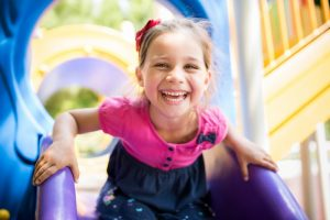child smiling on playground