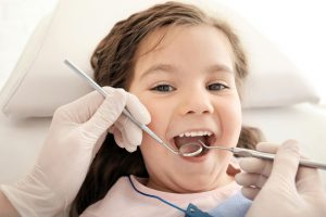 child receiving a dental examination