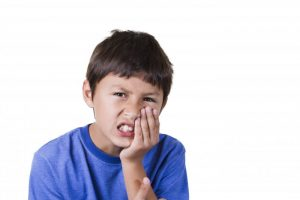 boy with tooth pain