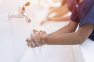 Kids hand washing at the sink